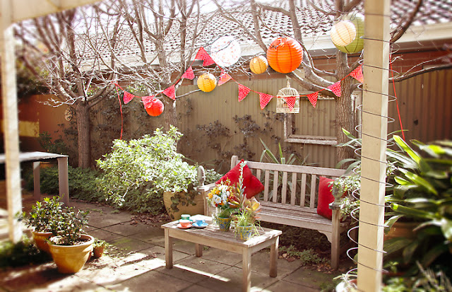 Colourful paper lanterns and garden setting - Perle Jewellery & Makeup