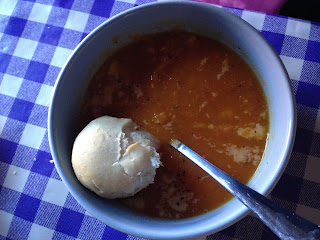 Bowl of vegetable soup with crusty bread