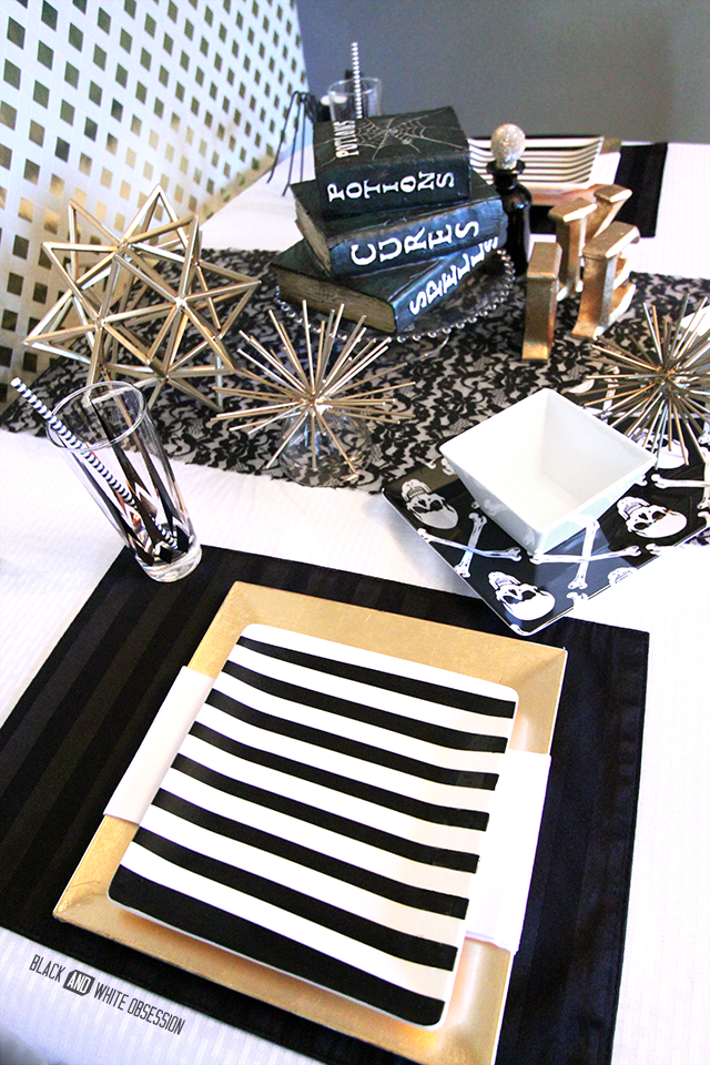 Black and Gold Glam Halloween Tablescape: Striped Plate | www.blackandwhiteobsession.com