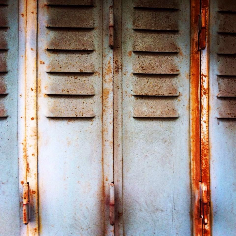 rusty shutters in Bourganeuf, Limousin
