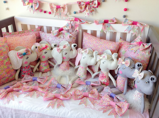 Group shot of Elephant Dolls cushions and bow garlands