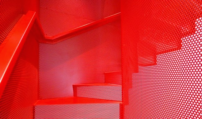 Striking Suspended Metal Staircase Design In Bold Red