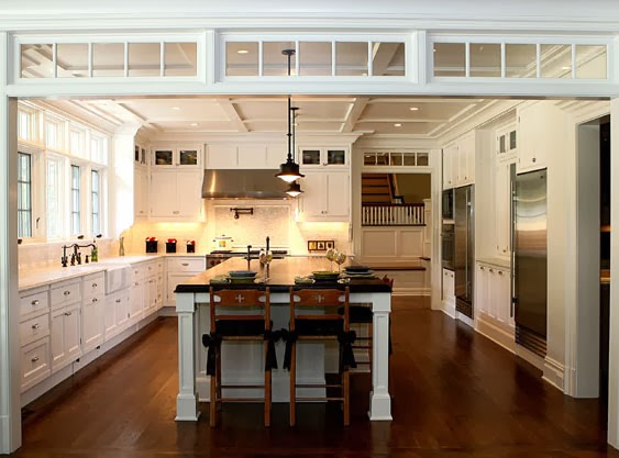 Transom windows define the space between a kitchen and living area