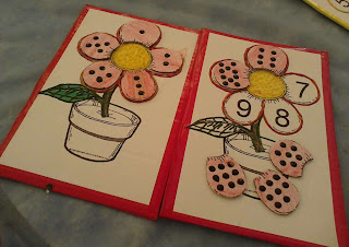 Tabuleiro (vermelho) do jogo das flores para trabalhar número e quantidade