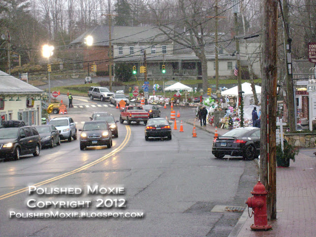 Image of Sandy Hook main street with memorials at center.