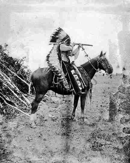 Native american gets totem pole in wigwam