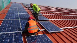 Installing Solar Panels on Industrial Building Roof