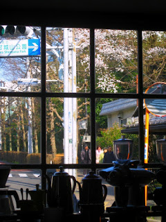 Coffee shop window with sakura in the background
