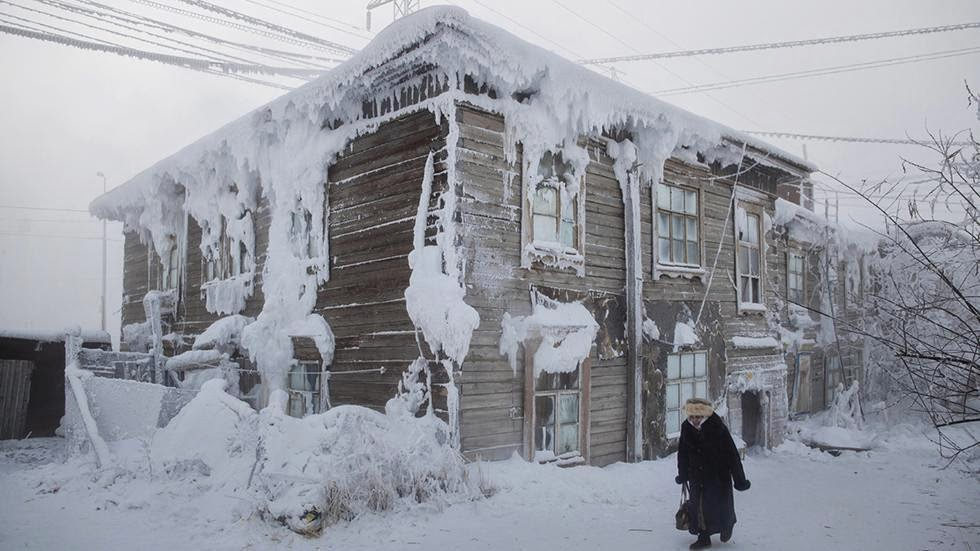 A house is encrusted in frost in the city center. - Welcome to The Coldest Place Inhabited By Humans on Earth