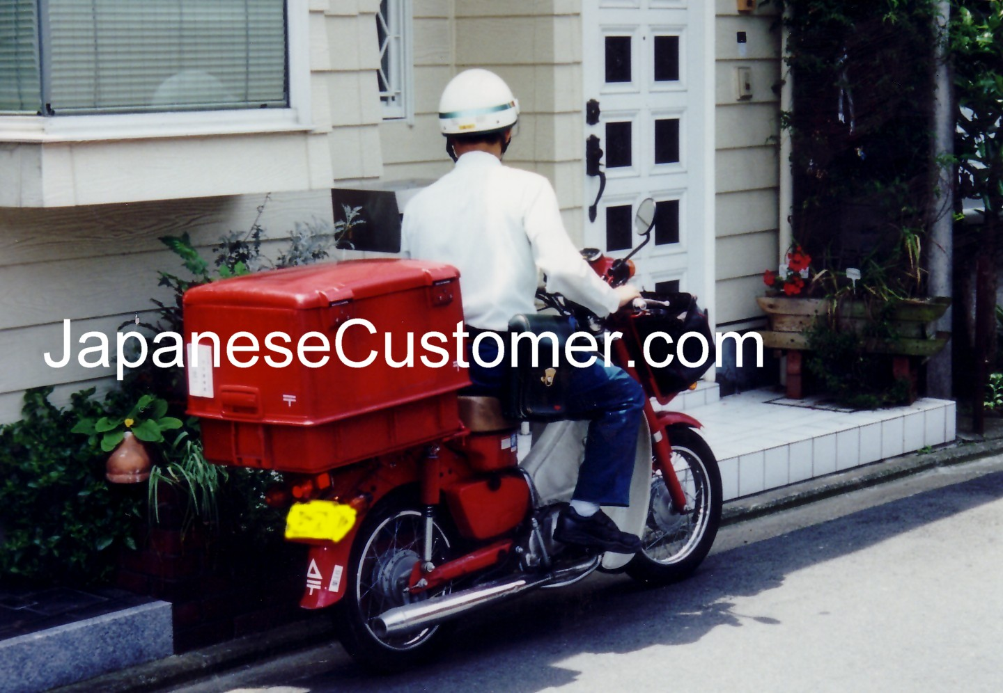 Japan Post delivering mail in Japan Copyright Peter Hanami 2014