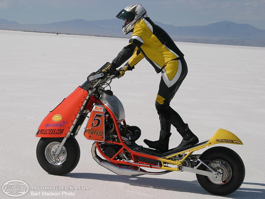 Motorcycle 74 stand up scooter cr500 motor bonneville for Stand on scooters with motor