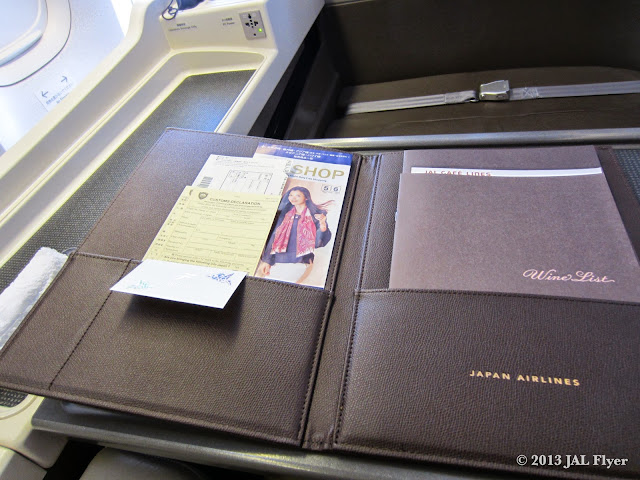 Inside of the JAL First Class leather portfolio binder.