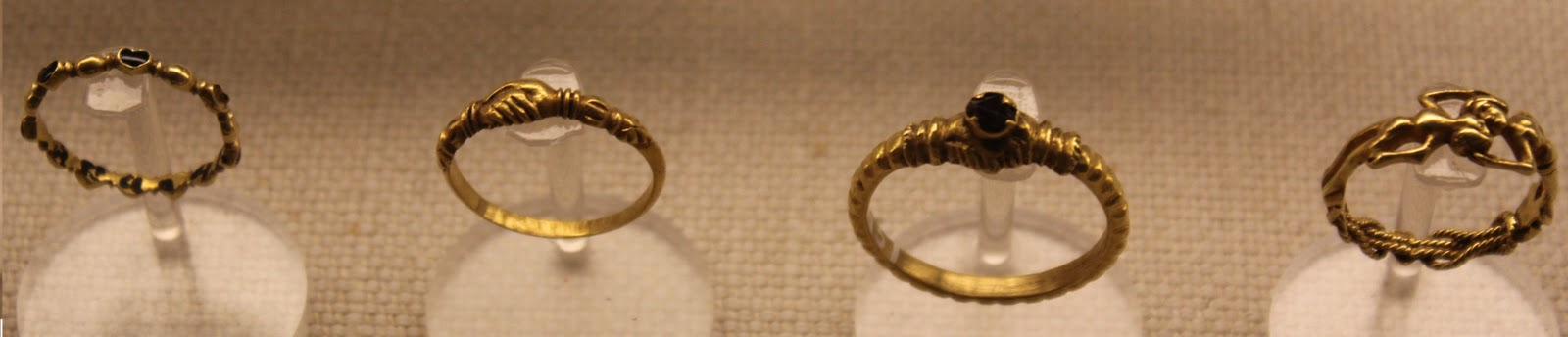 i love the one on the right with the man and the woman holding eachother the second one from the left features two hands coming together and is a fairly - Medieval Wedding Rings