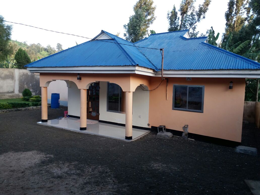 The house for sale has main house 3 bedroom and small house 2 bedroom land size architectural house designs in tanzania