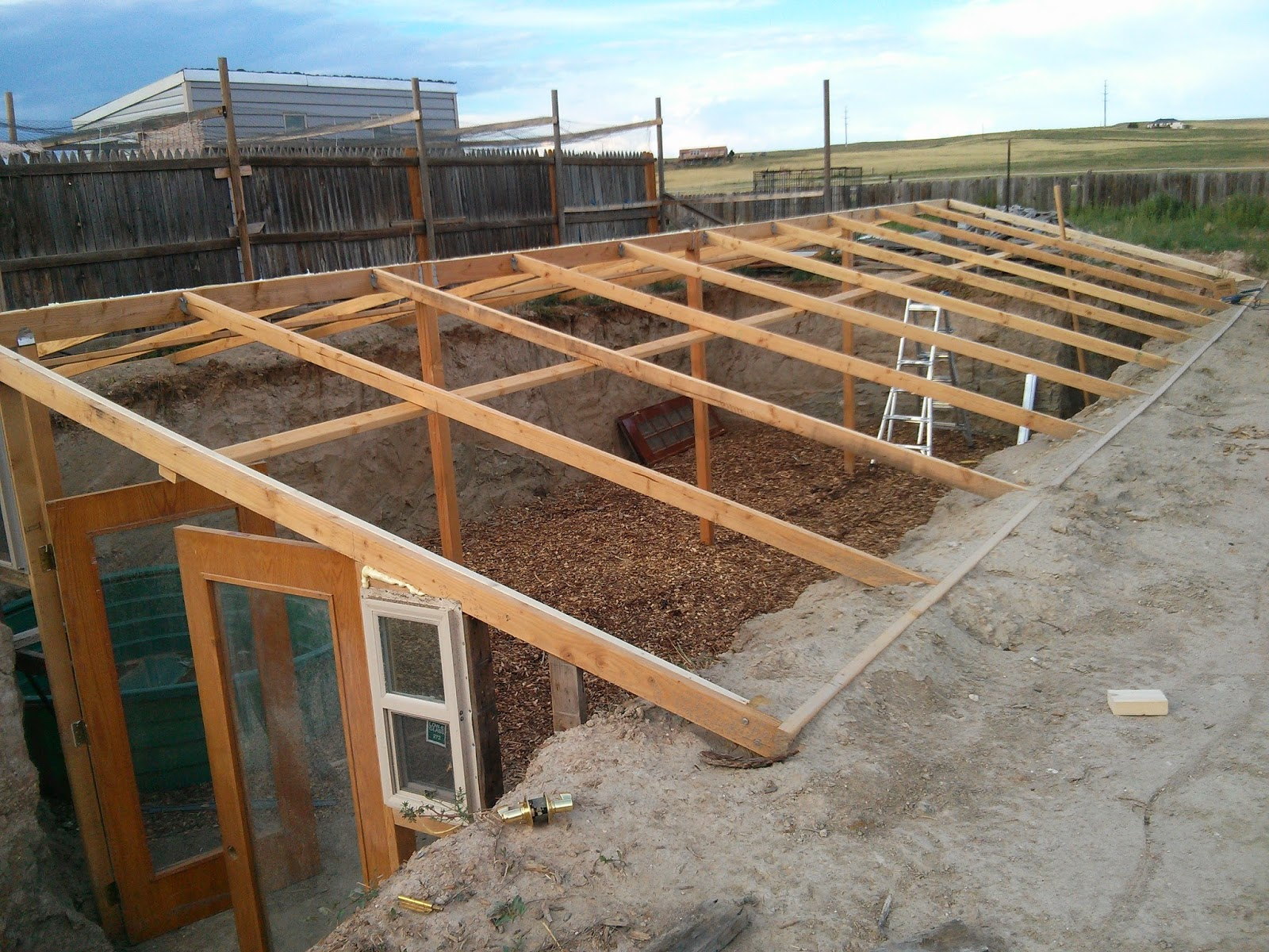 Walipini and aquaponics into new territory for Build green home