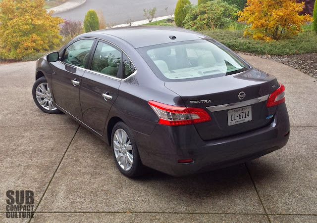 2013 Nissan Sentra SL high rear quarter shot