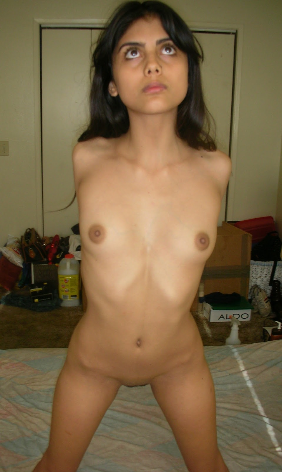 Old whore standing naked