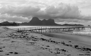 A photo of the landscape, with emphasis on the flimsy dock, at the El Nido airport, in the Philippines.