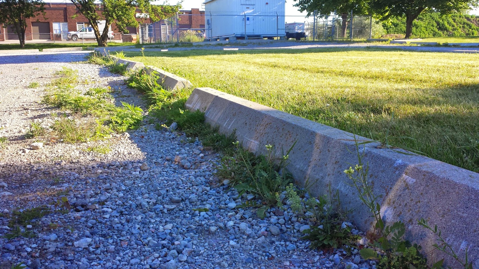 Concrete blocks found in parking lots to mark the curbs.