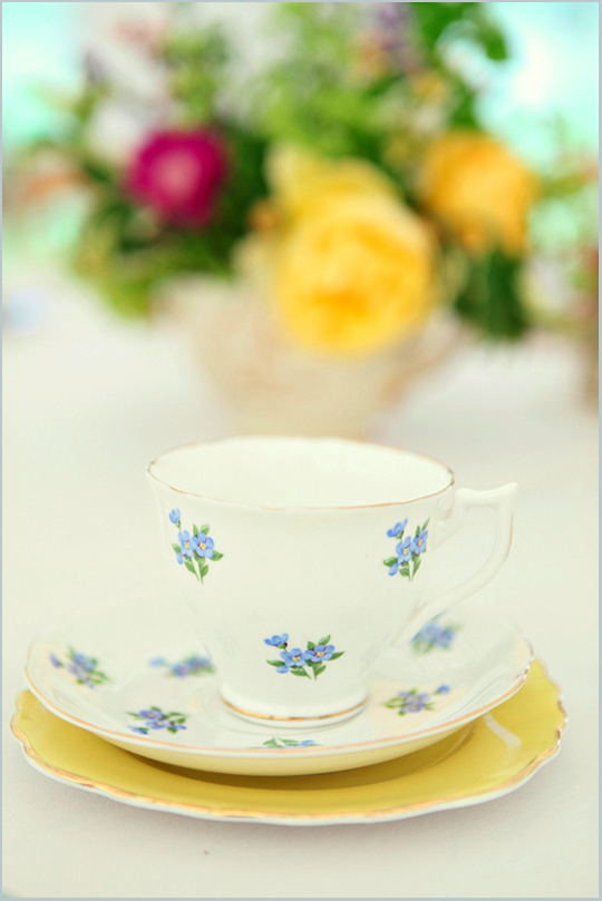 blue and white vintage floral teacup on yellow plate
