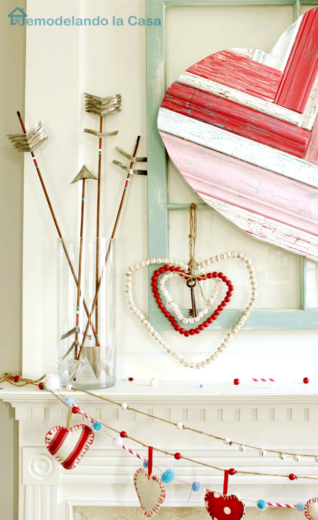 Valentine's day mantel with rustic arrows and hearts