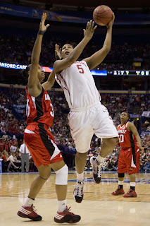 Ashley Paris #5 of the Oklahoma Sooners drives to the basket against Angel McCoughtry #35 of the Louisville Cardinals during the NCAA Women's Final Four Semifinals at the Scottrade Center on April 5, 2009 in St. Louis, Missouri. The Cardinals beat the Sooners 61-59. (Dilip Vishwanat/Getty Images) * Local Caption * Angel McCoughtry;Ashley Paris (April 5, 2009 - Source: Dilip Vishwanat/Getty Images North America)