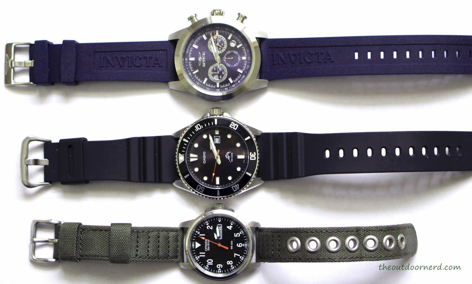Casio MDV106-1A Diver's Watch: Shown With Citizen and Invicta Watches
