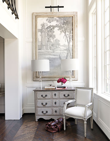 The Entrys Framed Wallpaper Fragment And Antique French Chest Establish Neutral Palette Of House