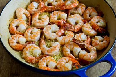 all the shrimp over and add the garlic. Continue to cook until shrimp ...