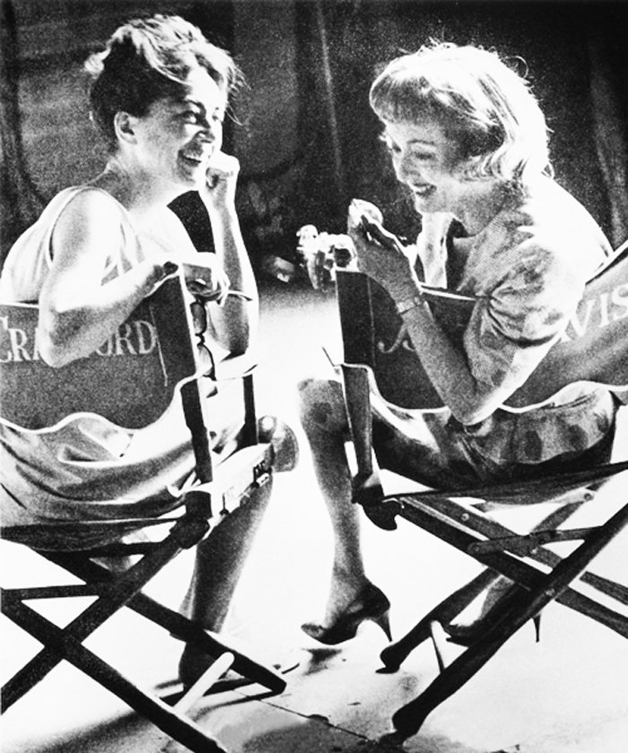 Joan Collins, Bette Davis. National Examiner. February 15, 1983. VG