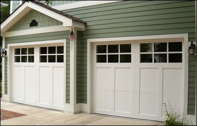 Big news about our little house little house of four for Wood garage doors michigan
