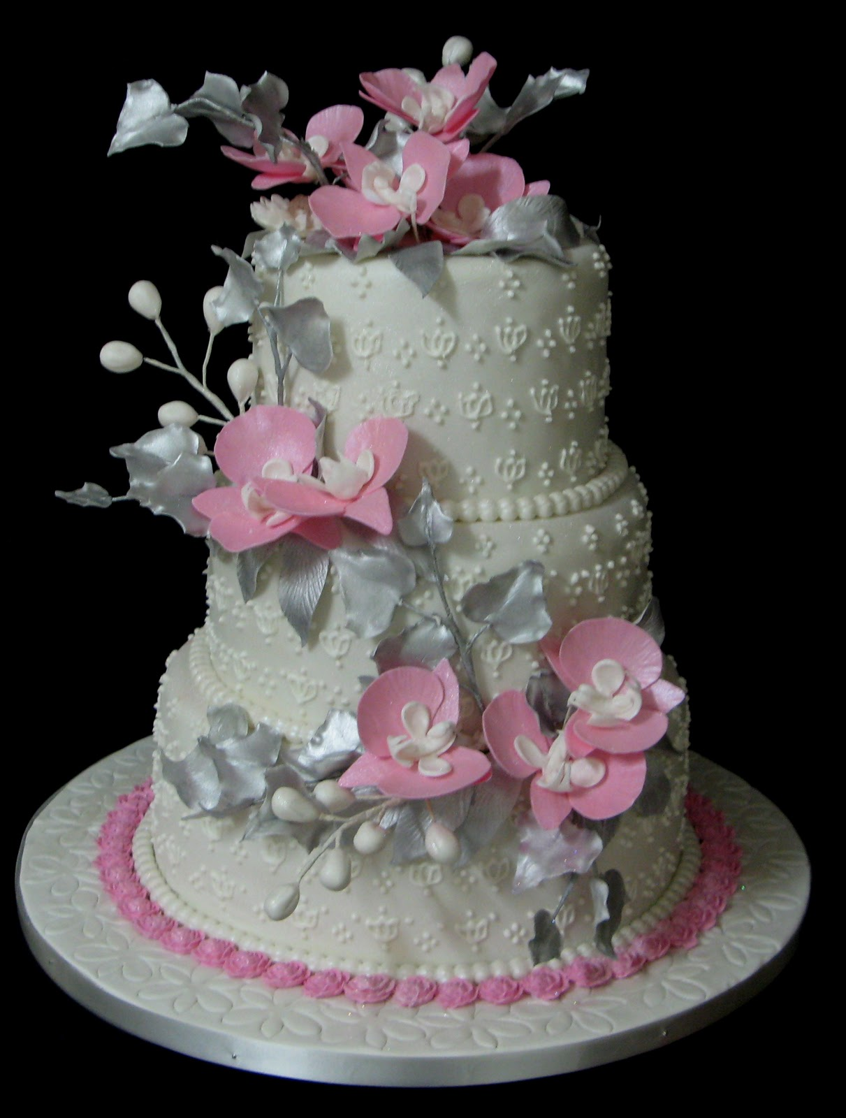 Sugarcraft by soni three tier wedding cake silver leaves and pink this cake was made for a bride from gaborone whose wedding theme was sliver pink and white quite a learning curve on balancing the flowers and leaves on mightylinksfo Image collections