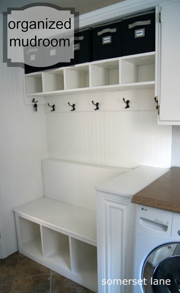 laundry room turned into organized mudroom with cubbies and hooks