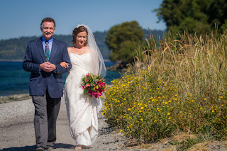 Alisha walks on the beach with her father - Patricia Stimac,Seattle Wedding Officiant