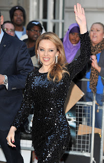 Kylie Minogue waves to the fans