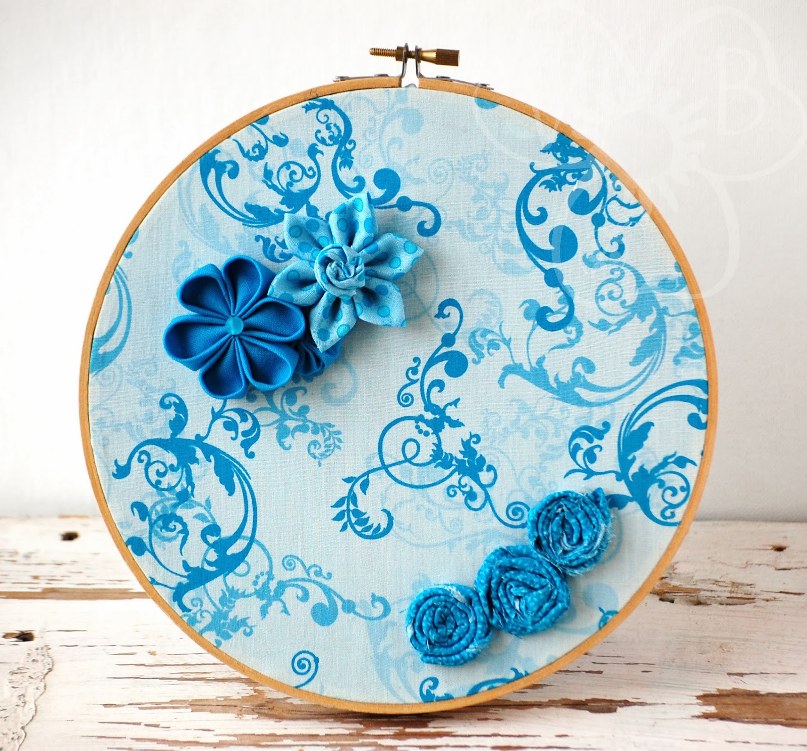 http://violetsbuds.storenvy.com/collections/500953-hoop-art/products/4643002-ocean-blues-handmade-flower-hoop-art