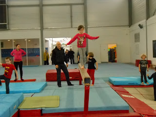 gymnast walking on beam