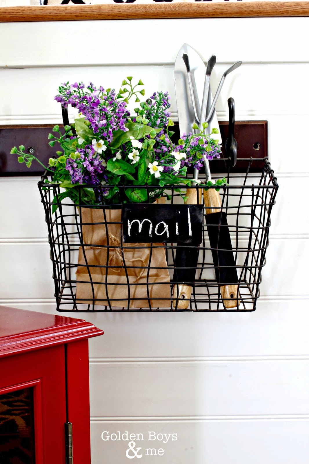 Wire mail basket with spring flowers and gardening tools-www.goldenboysandme.com