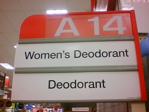 "A store aisle sign that says ""Women's Deodorant"" above and ""Deodorant"" below."