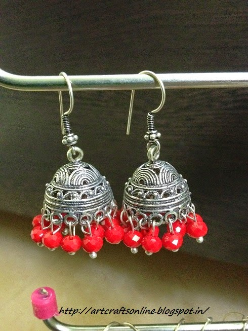 silver jhumka with red crystals