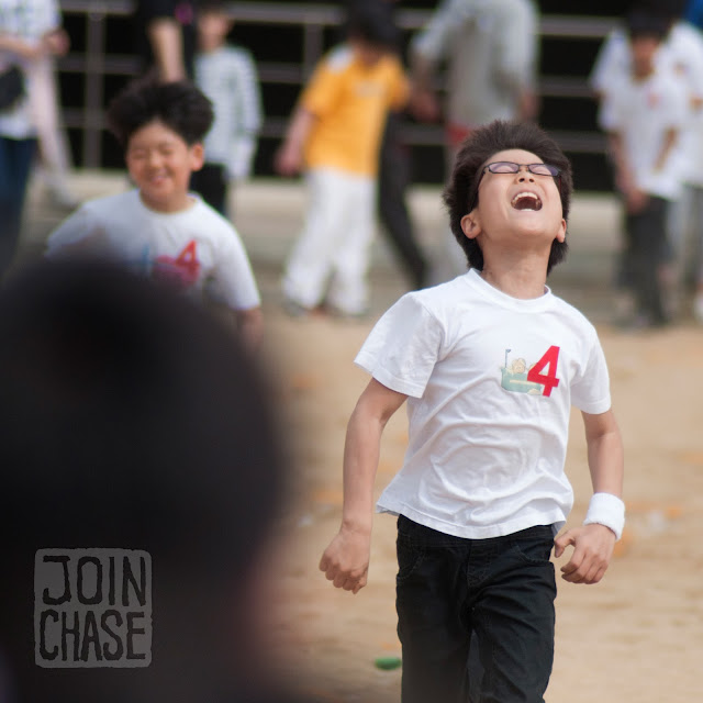 A Korean student running to the finish line during Sports Day at Bibong Elementary in Ochang, South Korea.