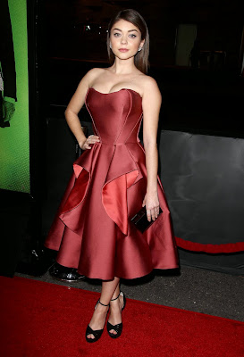 Sarah Hyland wear strapless scarlet dress attends the premiere of Vampire Academy
