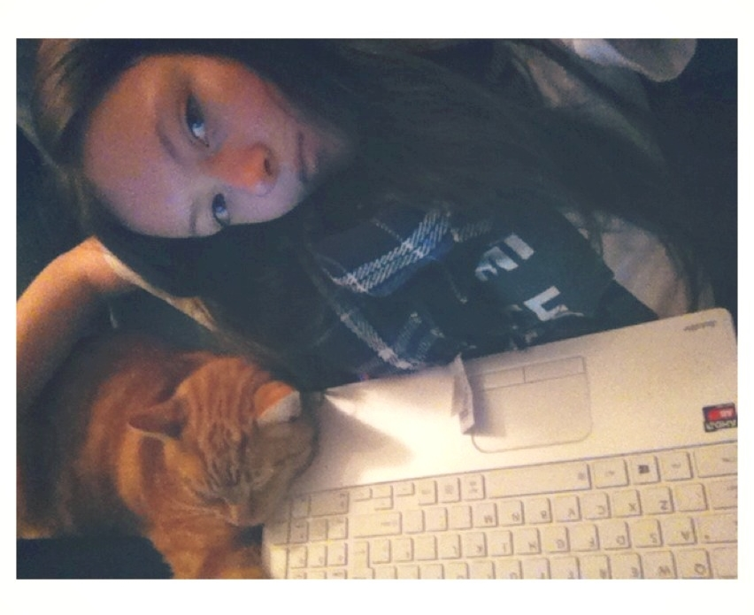 girl with ginger cat sleeping on keyboard