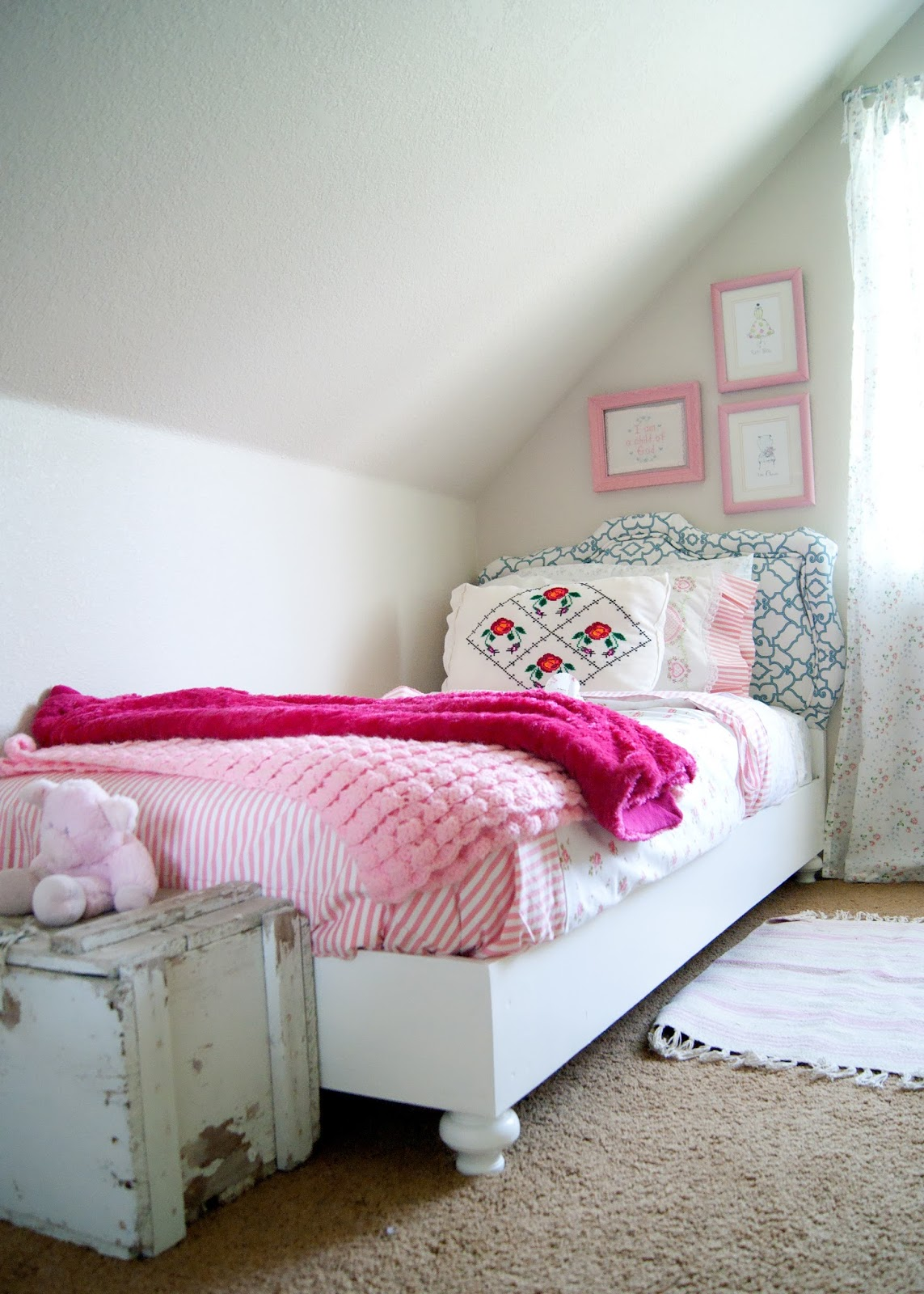 DIY bed, vintage headboard, vintage linens and old toolbox