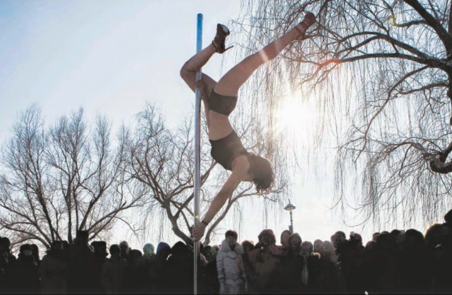 Pole dancing in sub-zero weather at a park in Changchun, in China's Jilin province