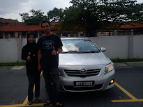 hubby and me with Altis
