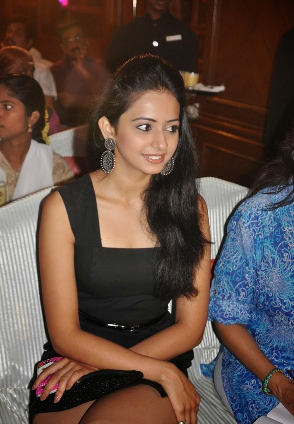 sexy hot bollywood actress rakul preet singh looks very hot and sexy in her black mini skirt exposing her black underwear wardrobe malfunction hd pics