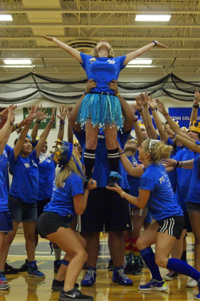 OL Katie being lifted up during team blue's cheer