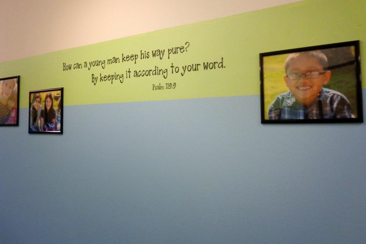 Sunday school hallway with photos of kids