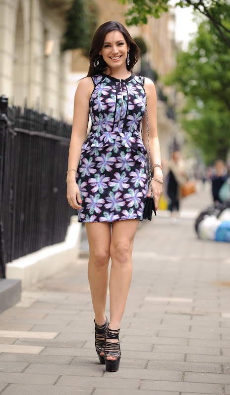 Kelly Brook leggy in a short dress and black high heels